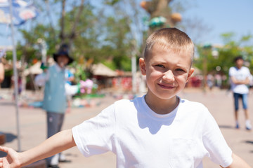 Boy at an amusement park
