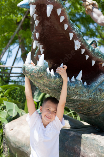 Boy and crocodile sculpture