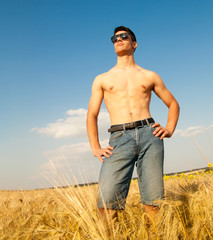 young man on wheat field