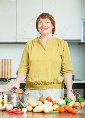 woman with potatoes in kitchen