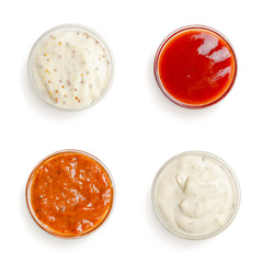 sauces in a gravy boat on white background