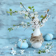 easter eggs and blossom apple tree in vase
