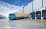 Unloading cargo truck at warehouse building poster