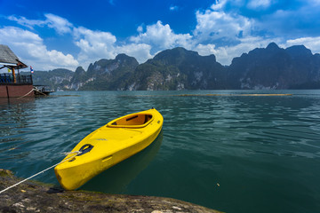 Yellow kayak floating on green water, khaosok, thailand