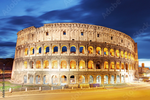 canvas print picture Colosseum at dusk in Rome, Italy