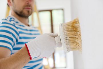 Man painting the walls