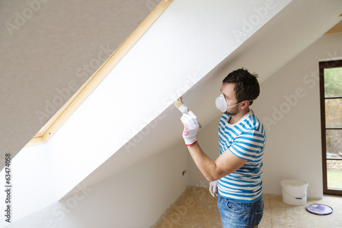 Man painting the walls