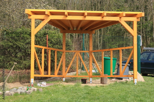 Wooden pergola painted yellow glazing