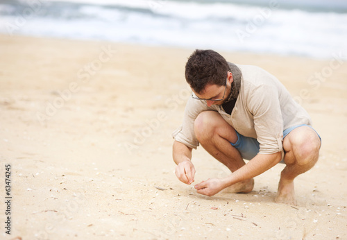 Man collecting shells