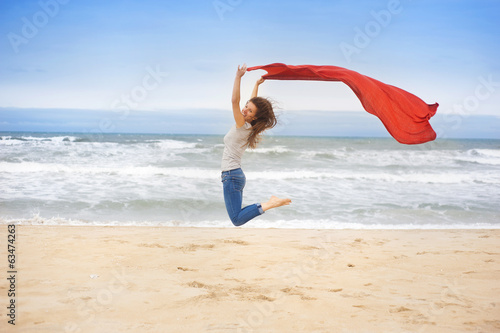 Sport woman jumping at the beach.
