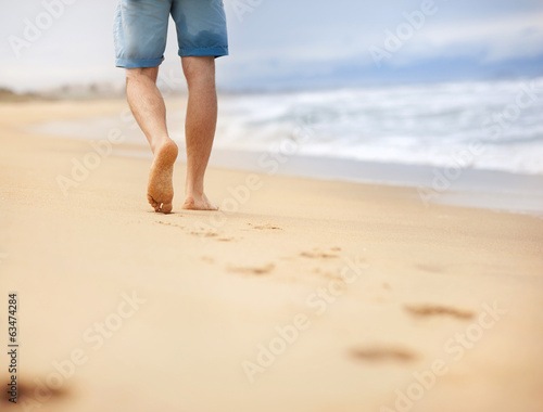 Man wallking at the beach