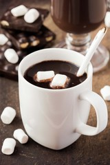 Drink hot chocolate with marshmallows in white cup