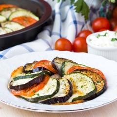 Ratatouille, vegetables cut on slices, eggplant, zucchini, tomat