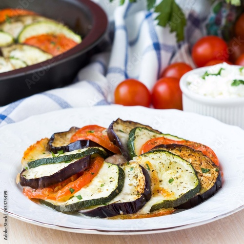 Ratatouille, vegetables cut on slices, eggplant, zucchini, tomat