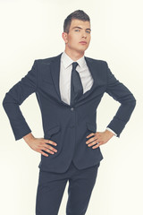 A businessman in a black suit