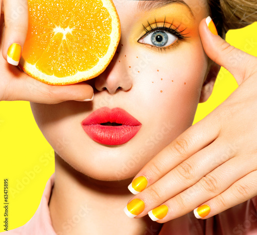 Teen girl with freckles, red hairstyle, yellow makeup and nails