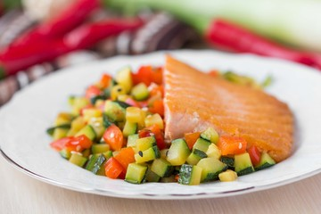 Fried fillet of red fish salmon with roasted vegetables