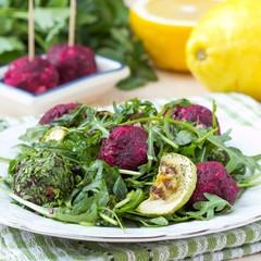 Fresh summer salad with arugula, zucchini, balls of beet