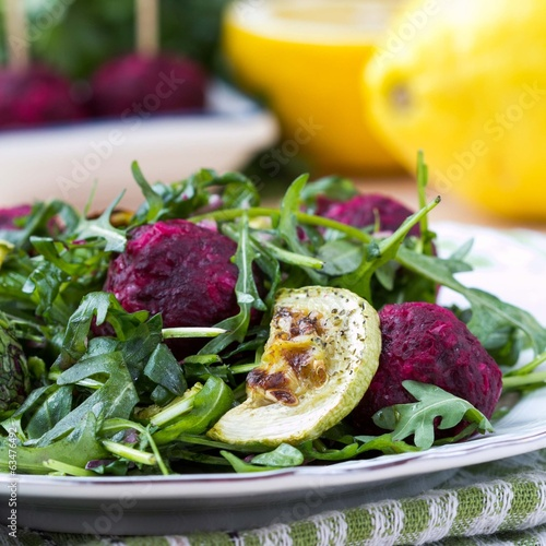 Fresh summer salad with arugula, zucchini, balls of beet