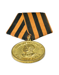 "Soviet medal ""Victory over Germany"" on white background."