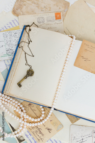 empty vintage book page with key