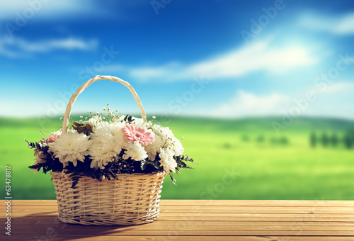 flowers on table and spring field