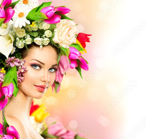 Spring woman. Beauty model girl with colorful flowers hairstyle