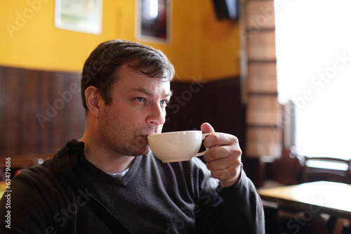 Man drinks tea