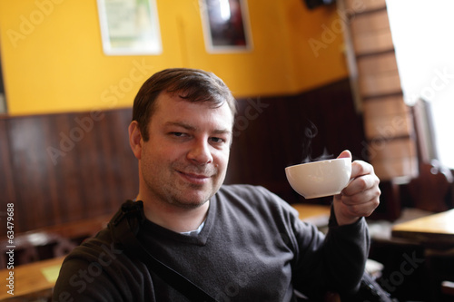 Man with cup of hot tea