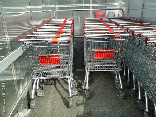Shopping baskets connected by chains