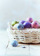 Basket of Colorful Quail Eggs for Easter