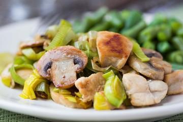 Chicken fillet fried with leek, mushrooms, green beans, sauce