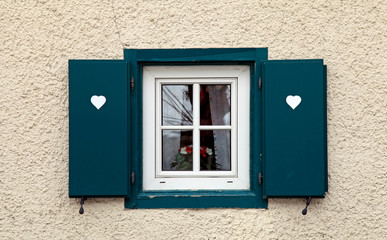 bavarian small window with green shutters