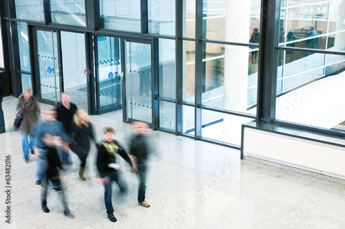 People Walking in Modern Office Building, Motion Blur