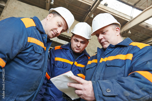 industrial workers on house building plant