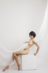 Beautiful body of woman with perfect skin with a cloth