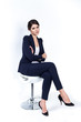 successful business woman in chair on white background - 63483087