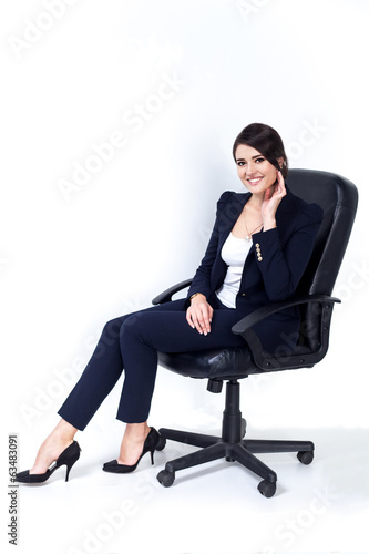 successful business woman in chair on white background