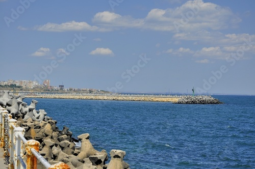 Harbour entrance with concrete block breakwater