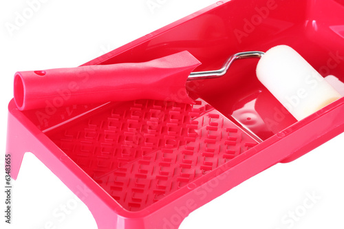 Paint roller with tray isolated on white close-up