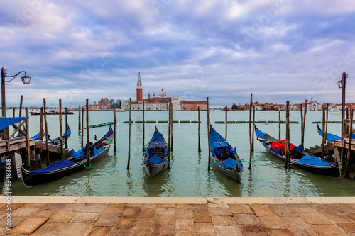 Gondolas on Grand Canal under overcast sky in Venice.