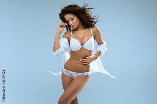 Young beautiful woman in sensual poses