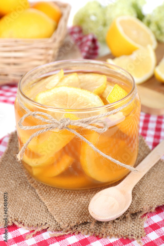 Tasty lemon jam on table close-up