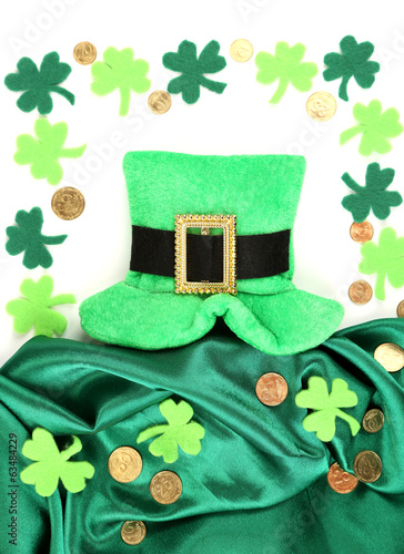 Saint Patrick day hat with clover leaves and golden coins,
