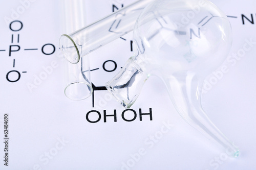 Test tubes and reaction formula, close-up