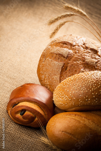 assortment of fresh baked bread on burlap