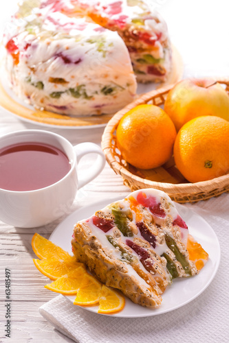 delicious jelly cake with tea and fruit on the table