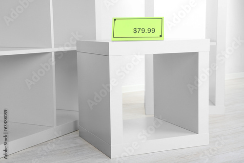New white shelves with price on light background