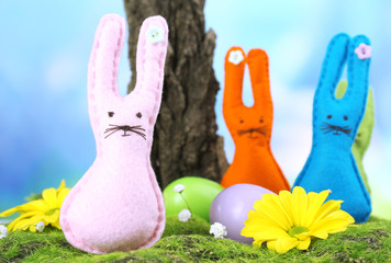 Funny handmade Easter rabbits on nature background