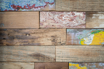 Detail of a board with old paint on it.